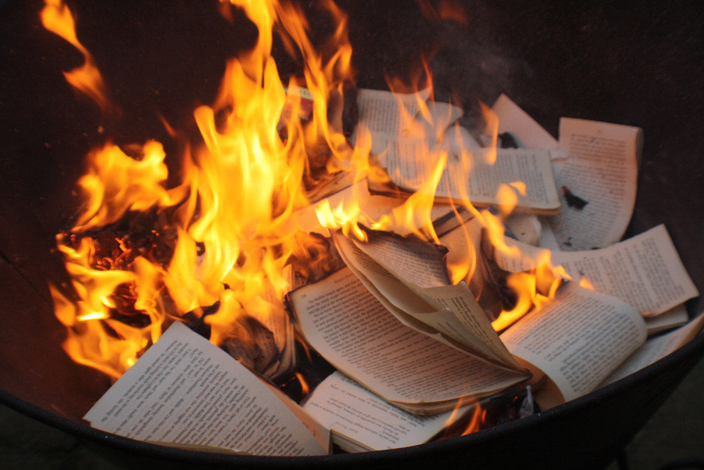 Where will the harness of the books burn people?